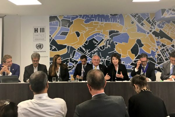 IHC Global President and CEO Judith Hermanson and IHC Global Boardmember David Wluka speak at the Habitat for Humanity International and Government of Dubai-led event Housing at the Center