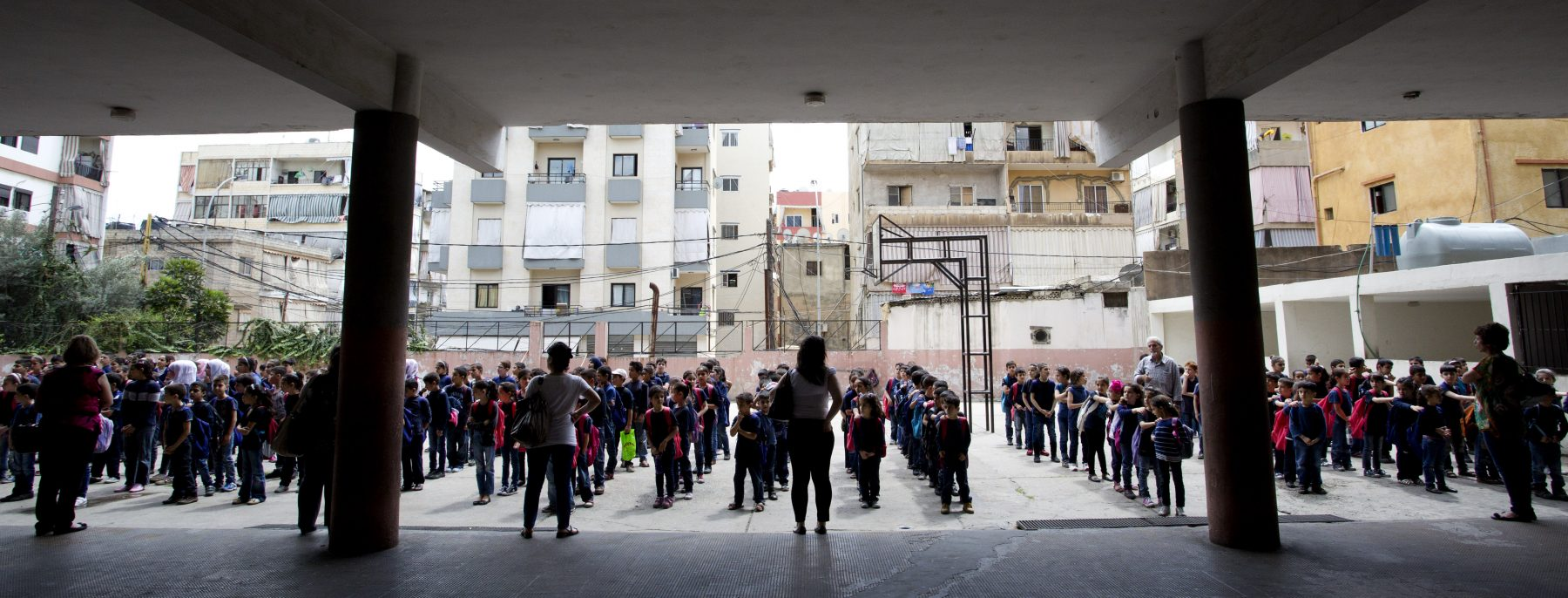 Syrian refugee students line up for classes at Bourjhammoud Public School #2 in Beirut, Lebanon on June 2, 2014. Photo © Dominic Chavez/World Bank